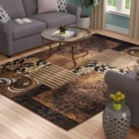 A silent style statement, this indoor area rug combines elegance with modernity in flawless form. This trend-setting design incorporates scrollwork, brocade and floral patterns in hues of brown, black and white, creating a daring tableau. Made in Turkey, this item's high-density pile makes for a cushioned space while repelling dirt and debris, while a drop-stitch construction adds a carved look. No matter where you lay out this rug, we recommend a rug pad for added grip.