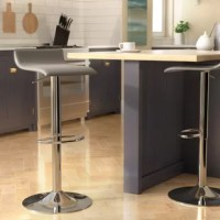 Whether pulled up to a pub table or making your kitchen island more eye-catching, this bar stool is the perfect perch. Designed to fit the counter of your choice, it offers an adjustable height that can extend from 26.5'' up to 34.75'' tall. This piece is ideal for more modern ensembles, pairing a polished chrome-finished metal pedestal base with a low-back seat wrapped in non-fussy faux leather upholstery with a neutral gray/black/brown/white hue.