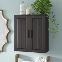 Bathroom clutter, begone! An essential for any bathroom, cabinets keep prescriptions, bandages, toiletries, towels, and more in one centralized location while keeping your floor space clear. Crafted from manufactured wood, this wall-mounted cabinet showcases two beadboard doors in a neutral espresso finish, perfect for a wide variety of powder room aesthetics. Two doors with knobs in a chrome finish conceal one fixed shelf and one adjustable shelf. Be sure to have drywall anchors and screws on...
