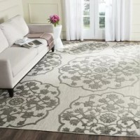Blooming in style, this Gray/Cream Indoor/Outdoor Area Rug brings the perfect foundation to your home decorating needs. Elegantly embellished with a sophisticated floral design that makes medallion-inspired shapes, this beautiful piece instantly adds texture, dimension, and feminine flair to any floor it graces. The large and bold nature of the pattern fits seamlessly with any modern aesthetic. Take advantage of its polypropylene and polyester blended material to bring a durable...