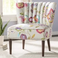 Liven up your living room seating group with this Harriett Slipper Chair, or place it beside a sunny window to craft an inviting reading nook.