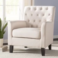 Whether it's used to round out your living room look or acting as the star of an inviting reading nook, this armchair is a perfect pick for your home. Founded atop four tapered, wood feet, this design's frame strikes an understated silhouette brimming with classic charm. Linen upholstery introduces a textural touch, while button tufts along the back emphasize the traditional aesthetic of this must-have design. Polyester fill in the cushions completes it.