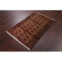 A beautiful geometric area rug hand-knotted by skillful weavers in Central Asia made with 100% wool.