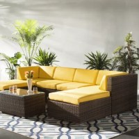 Set an understated and approachable foundation in your outdoor seating space with this seven-piece sofa set, including two corner chairs, two armless chairs, two ottomans, and one rectangular coffee table. Crafted with an aluminum frame, each piece is founded atop stainless steel feet and wrapped in neutral PE resin wicker for a weather-resistant design. Their clean lines give them a contemporary feel, while solid-hued cushions complete the arrangement with a boost of comfort.