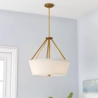 Illuminate the entryway or dress up the dining room with this pendant, an easy fit for both casual and upscale areas of your abode. Crafted from metal, its understated frame features several down rods for a rustic touch. Four lights inside are highlighted by a tapered fabric drum shade, casting a warm glow up towards the ceiling.