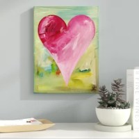 'Mumbai' - Wrapped Canvas Print features a pretty in the pink heart with an assortment of shades from magenta to baby pink on a background fusion of turquoise and gold. This tribute piece represents the beauty of feminine strength. Handcrafted in the United States, this vertical gallery-wrapped canvas art arrives ready to hang on your wall. Decorate any wall in your space, with a print that is easily adaptable with most styles of decor.