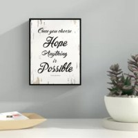 This uniquely designed 'Once You Choose Hope Anything is Possible Christopher Reeve' Framed Textual Art on Canvas is the perfect gift or trendy update to any home or office space. An excellent addition to your classical design concept in your kitchen, bathroom, bedroom, man cave, game room, living room or studio. This manufacturer is a shop that specializes in home decor. The manufacturer create handmade art for every budget. Beautiful giclee prints on canvas with a custom picture frame for all...