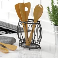 Give whisks, spoons, and spatulas a place to call home atop your kitchen counters in this stylish utensil crock. Wrought from stainless steel, this accent features leafy openwork details and a mesh bottom that prevents moisture from pooling up, while a built-in center divider bar keeps your utensils upright and organized. At a budget-friendly price, what's not to love? Avoid putting this item in the dishwasher; instead, wipe down with a damp cloth and towel dry.