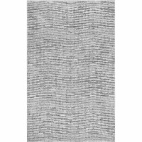 This polypropylene rug is both elegant and easy to clean, so they make the perfect foundation for any entryway ensemble. Try rolling out this alluring area rug for a ravishing refresher, then craft a cohesive look throughout with a glossy white bench for stowing shoes and a polished silver bowl pendant hanging overhead to make it shine. Though its hues of gray are sure to beautifully blend into your abode, a tonal stripe motif might just be grabbing glances. Made in Turkey, this distinctive...