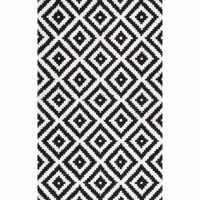 Set an artful foundation in your living room seating ensemble or give the master suite a makeover from underfoot with this essential area rug. Its bold geometric pattern makes it a perfect pick for modern spaces. Made in India, it's hand-tufted using wool with a low pile height that's easy to maintain with regular vacuuming. This piece is backed, so we recommend a rug pad to keep it safely in place.
