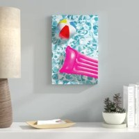 This contemporary 'Swimming Pool Toys' Graphic Art on Canvas decor features inflatable pool toys floating water. Made ready to hang with hangers, this canvas art is perfect for your pool house, beach house, indoor deck or patio. Canvas Wall Art enhances your space during any time of the year. Solid and durable canvas is ready for hanging.