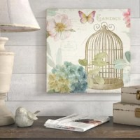 If bare walls are starting to wear on you, brighten up with a piece of wall art tailored to your home's style, like this piece! Perfect for livening up a dreary den or listless living room, this piece showcases a watercolor painting print of a bird cage surrounded by flowers, leaves, and a butterfly. Handwritten notes in this piece's background lend it a vintage-inspired touch. Printed in North America on canvas, this piece showcases a gallery style look perfect for your walls.