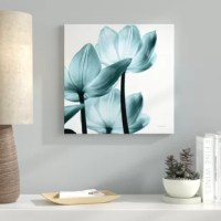 From setting the aesthetic of a room to showcasing your taste, wall art offers a way to incorporate ourselves into our home decor. Just take a look at this eye-catching piece, for example, This photographic print brings a bit of botanical beauty to your arrangement, showcasing three blooming tulips in shades of blue and white. Whether put on display in your own home or used as the perfect housewarming gift, this piece is sure to make a bold statement on any bare wall.