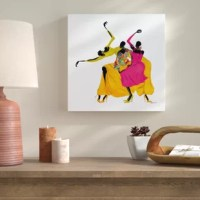 'Go Sally Go' Graphic Art Print on Wrapped Canvas is a beautiful reproduction featuring three African-American ladies dancing with one another. A conversation piece that will compliment any home or office.