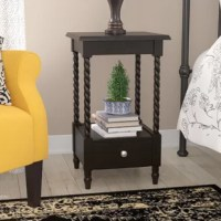 Defined by a simple two-tiered design and low-key look, this charming nightstand offers a timeless and transitional touch to any ensemble. Let a pair flank a matching wood nightstand in the master suite to keep glowing table lamps on display, then use the lower display shelf to stack your before-bed reading list. Featuring a single drawer, this design makes a simple storage solution for little odds and ends, while it turned, carved spiral pillars play perfectly with scrollwork pillow shams and...