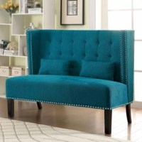 The classic sheltered wing-style Robeson Traditional Loveseat chair in color is embellished with nailhead trim and smooth and finish