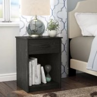 Keep your bedroom essentials within arm's reach with the Bowdoin 1 Drawer Nightstand. This Nightstand is a convenient addition to your bedroom as it not only provides extra storage space, but the traditionally simple style and the woodgrain finish works with any existing decor. This Nightstand is constructed of laminated particleboard for a cost-effective build that is both trendy and functional. The Nightstand has a bottom cubby that can be used to store books or magazines while the drawer...