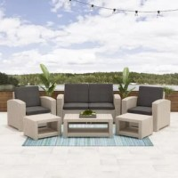 Relax in style this summer with this unique 6 piece patio set. Includes 2 chairs, 2 ottomans and a coffee table crafted entirely from durable, weather-resistant. High-Density Polyethylene (HDPE) pressed-resin wicker. Engineered to give you a natural-looking wicker rattan design that will complement any patio or garden, this set is virtually maintenance free, rustproof, and decay proof. Assemble your new patio set in minutes allowing you even more time to enjoy your outdoor space. This...
