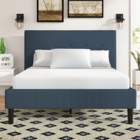 There's no better way to complete your master suite than with a carefully-chosen bed! Take this design, for example, classic styling and button-tufted details make this the perfect pick for contemporary rooms. Founded atop a metal frame, its headboard is wrapped in 100% polyester in a neutral navy hue that fits with any aesthetic, while a foam fill provides support when you're watching TV or reading in bed. Slats are included.