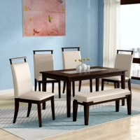 Create a cohesive contemporary aesthetic in your entertainment ensemble with this six-piece dining set, complete with one rectangular table, four side chairs, and one bench to offer seating for six. Crafted from manufactured wood, each piece sports a versatile espresso finish that's understated enough to complement most color palettes. Easy-to-clean faux leather upholstery in a neutral beige hue cushions each seat to offer subtle contrast, while a smoked glass insert rounds out the table with...