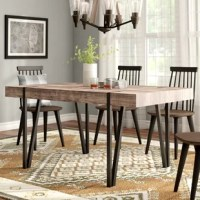 Rustic at heart yet in step with modern styles, this dining table lends a touch of warmth to your abode. Its clean-lined design is built from manufactured wood with a distressed pattern that lends lived-in charm to your dining room, while V-shaped legs crafted from iron complete the look. This table seats six for Sunday brunch or your latest soiree. Assembly is required, but all the necessary tools are included.