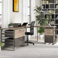 Anchor your home office with some industrial style using this three-piece set. Perch your PC or laptop on the L-shaped desk – measuring 30'' H x 61.42'' W x 49.13'' D – while storing office essentials in the three-drawer mobile filing cabinet that conveniently fits underneath. The included lateral file cabinet includes two legal-size drawers made from manufactured wood, one of which boasts a distressed gray finish while the other showcases a weathered, charred wood coloring.