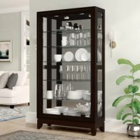 Display your curated collections with pride in this lighted curio cabinet. This curio strikes a tall, rectangular silhouette framed in beveled moldings and crafted of solid and manufactured wood in a rich chocolate cherry finish. Six adjustable glass shelves provide perfect platforms for displaying fine china, stylish sculptures, and more, while built-in lighting and a mirrored backing set a brilliant backdrop for your collections. Rounding out the design, beveled glass side panels and a...