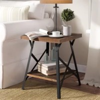 Pairing pinewood tiers with a powder-coated metal frame, this understated end table lends your living room layout a dash of rustic character as it provides a place for snacks, lamps, and more. A distressed brown finish outfits the square top and lower shelf for a warm and weathered look, while the openwork black-finished frame creates crisp contrast.