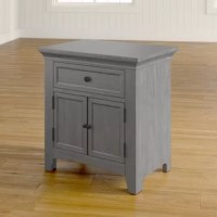 Traditional tastes meet modern amenities in this charming one-drawer nightstand! Crafted of solid and manufactured wood in an antique painted finish, this nightstand features crown moldings, recessed paneling, and aged hardware. Set on ball-bearing glides, one drawer includes a built-in power outlet for keeping e-devices on-hand and at-the-ready, while a two-door cabinet offers even more storage space for bedside accessories. Measures 30