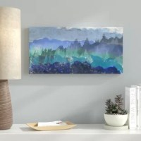 Walls looking a little bare? Plain? Drab? A budget-friendly piece of wall art is just the thing to fill in the gaps and spruce up your walls. Take this piece of photographic wall art for example: an image of a scenic forest covered mountain range; it is perfect for hanging in a living room, bedroom, den, and more. It is made in the USA, and printed on wrapped canvas. This piece arrive ready to hang and should be displayed horizontally.
