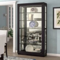Beautifully display your curated collections with pride in this lighted curio cabinet. This curio strikes a tall, rectangular silhouette framed in tasteful moldings and crafted of solid and manufactured wood in a rich, dark brown finish. Five adjustable glass shelves provide perfect platforms for displaying fine china, stylish sculptures, and more, while built-in lighting and a mirrored backing set a brilliant backdrop for your collections. Rounding out the design, beveled glass side panels and...