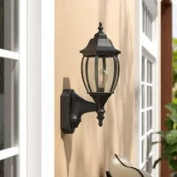 Greet guests with a warm and welcoming glow before you even reach the front door with this wall lantern, perfect for the porch or patio. Designed to live outdoors, this piece is constructed from weather-resistant steel that doesn't mind UV light or rain. Its classic lantern silhouette is a fine fit for modern farmhouses and stately estates, but a single light behind a glass shade is what really makes this luminary shine.