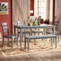 Looking to create an on-trend cottage dining ensemble, but don't know where to start? A set like this is a great option for settling down to a meal in classic country style. Crafted from solid rubberwood with a solid-hued finish, this six-piece set includes four chairs, a bench, and a table. The chairs feature a ladder back design for an additional traditional style, while the bench and table showcase a clean-lined silhouette. This set seats up to six people.