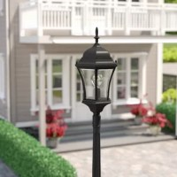 Light the way up to the front door or illuminate your back patio with this post lantern. Designed to live outdoors, it is crafted from weather-resistant metal that doesn't mind sunlight shining down or rainstorms rolling through. Its single light inspired is highlighted by a traditional molded frame and glass panels, giving it an Old World–inspired look. Founded atop a pole, this light measures 90'' tall. Some assembly is required.