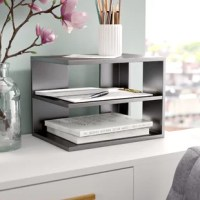 When decorating your home, it's always considered a win-win when something is both fashionable and functional. Take this desk organizer for example: Crafted from wood, it features three shelves that are ideal for tucking away paperwork, pens, pencils, and more. Showcasing a corner design (reversible for left and right corners), it measures 9.81'' H x 13.19'' W x 9.69'' D, perfect for the desk in any home office. Plus, its neutral hue allows it to blend with a variety of color schemes.