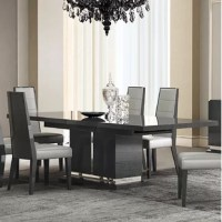 The manufacturer is proud to present this premium dining room. This Izquierdo Extendable Dining Table features a luxurious union of symmetrical. The table can be extended to accommodate plenty of seating. The vitrine features plenty of storage with glass. A beautiful collection fit for royalty.