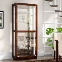 Shine a spotlight on stylish serveware, artful accents, and beyond with this lighted curio cabinet, complete with compatible halogen bulbs to cast light down on the five interior shelves. Crafted from solid wood with veneers, this piece sports a dark brown stain for a warm and versatile look. Clear glass panels make up the sides and four doors for a sleek touch, while a mirrored back helps bounce light around your room for a brighter feel. Measures 80'' H x 34'' W x 17'' D.
