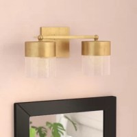 Mid-century modern design gets a glamorous update in this two-light vanity light! Crafted of steel in a hand-applied gold leaf finish, this fixture features a clean-lined 5