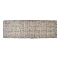 Anchor a serene design scheme in your bedroom with this Hand-Woven Wool Ash Gray Area Rug. The neutral dark night color takes on any palette you mix with it, and the felted wool offers tactile comfort and sensory warmth.
