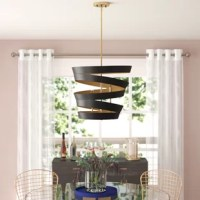 Chic and sculptural, this four-light geometric chandelier is like a modern art installation! Crafted of metal in a matte black finish, this fab fixture features a swirling, stacked ring shade with complemented by its satin gold inner lining. Capping four streamlined torch lights within, 60 W incandescent E12 candelabra base bulbs (not included) disperse ambient light throughout your space, while an adjustable length of downrod suspends the whole unit from a sloped ceiling-compatible canopy...