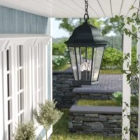 Add a touch of classic traditional flair to the exterior of your home with this antique inspired outdoor hanging lantern. Crafted for dry, or damp environments – you can feel comfortable knowing this light is safe under your covered porch, patio, or veranda during a storm. Constructed of metal, with a glass shade, this luminary accommodates three lightbulb of up to 60 W (bulb not included). This fixture measures 19.5'' H x 12.5'' W.