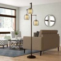 Perfect for illuminating a hand of cards or a late-night read, floor lamps are a stylish way to light up your space. Take this one for example: Crafted from wood and metal, this piece features a tree-inspired design with a slim trunk and three L-shaped branches, each supporting globe-like cages that lend instant eye-catching appeal to your arrangement. Three fabric shades diffuse light from any compatible bulb up to 60 W, while a damp location rating makes this product ideal for an enclosed...