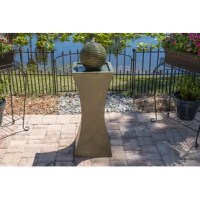 This Resin Solar Barcaccia Outdoor Solar Fountain with Light delivers a stunning fountain right into your outdoor space. The pedestal of the fountain is simplified, smoothed out hourglass shape that is in a soft gray color. The top of the pedestal holds up a large bubble-orb that comes in a moss stone finish. Water bubbles up and over the orb, spilling into a shallow pool below. The large orb causes the water to ripple down the sides, adding a touch of texture and depth to the bubble. With...