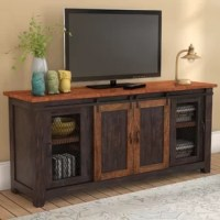 Fusing fashion with function, this TV stand is the ultimate focal point for your living room look or den ensemble. It accommodates a 70'' flat-screen and includes three cabinets for keeping DVDs and media players. Crafted from solid pine and pine veneers, it offers a rustic take on contemporary with clean lines and a weathered two-tone finish.