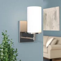 If you're looking for ways to add lighting to a room, but can't sacrifice on square footage or surface area, a wall sconce might just be the luminary for you. Great for (literally) brightening up bare walls, a sconce like this is perfect for understated modern style thanks to its cylindrical, etched white glass shade and understated arm. This luminary accommodates a single 100 W bulb, although none is included. And since it's designed with damp spaces in mind, it can be used everywhere from the...