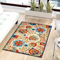 With summer rainstorms rolling through, UV rays beating down, and plenty of foot traffic at pool parties and BBQs, your alfresco ensemble's foundation needs to be a polypropylene rug. Take this one, for example: made in Turkey, it is power loomed from that must-have material with a low pile height for easy upkeep. Plus, it lends a pop of garden-inspired style with a scrolling floral motif in hues of red, green, yellow, and blue.