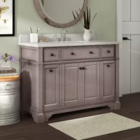 Traditional charm meets contemporary flair with this vanity base. This single vanity set is crafted of solid poplar wood, with a white marble top, and a rectangular undermount ceramic sink. It features one center cabinet, and four functional drawers for plenty of concealed storage of crisp towels, cleaning supplies and more. It measures 39'' H x 48'' W x 22.4'' D, with an 8