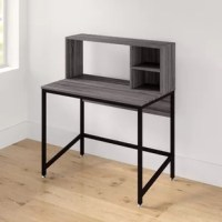 Whether you're making the most of an unused living room corner or creating a dedicated study, your desk should lend you the perfect workspace to tackle your to-list in style. Take this desk, for example: perfect for a clean-lined modern look with handy storage, it's crafted from a metal base and is capped with a manufactured wood surface and hutch. Two exterior shelves in the hutch lend this piece handy storage for your office essentials. Measuring 46.3'' H x 39.4'' W x 23.6'' D, this piece is...