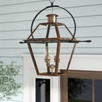 Your outdoor lighting is an important touch to rounding out your home: not only does it make your spaces safer by brightening up the night, but it also sets the tone for your home decor from your front door. And with a hanging light like this, you can add a touch of rustic-inspired style to your outdoor space: crafted from metal with a classic gas lamp silhouette, it features an aged copper finish with  glass panels and loop accent. This luminary accommodates four 60 W bulbs, although none are...