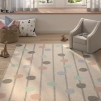 Who says artful appeal has to be limited to what's hanging on your walls? Whether rolling out in the living room or master suite, this eye-catching area rug acts as both a foundation and a focal point. It offers a low pile height for easy vacuuming.